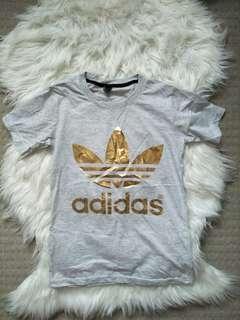 Adidas gold shirt in grey