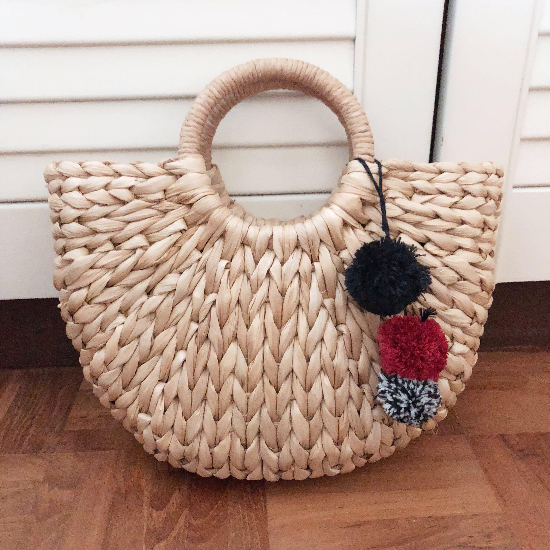 f67c23bc4a Bali Straw Bag Top Handle Pom Poms