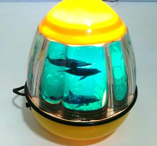 Lighted lamp with dolphins display
