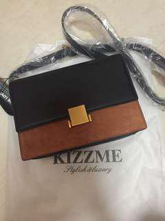 Kizzme leather message bag