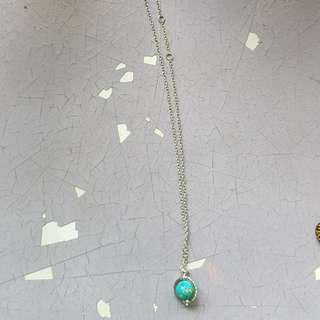 Rotating globe necklace