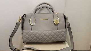 STEVE MADDEN GRAY BODY BAG