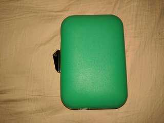 green clutch bag