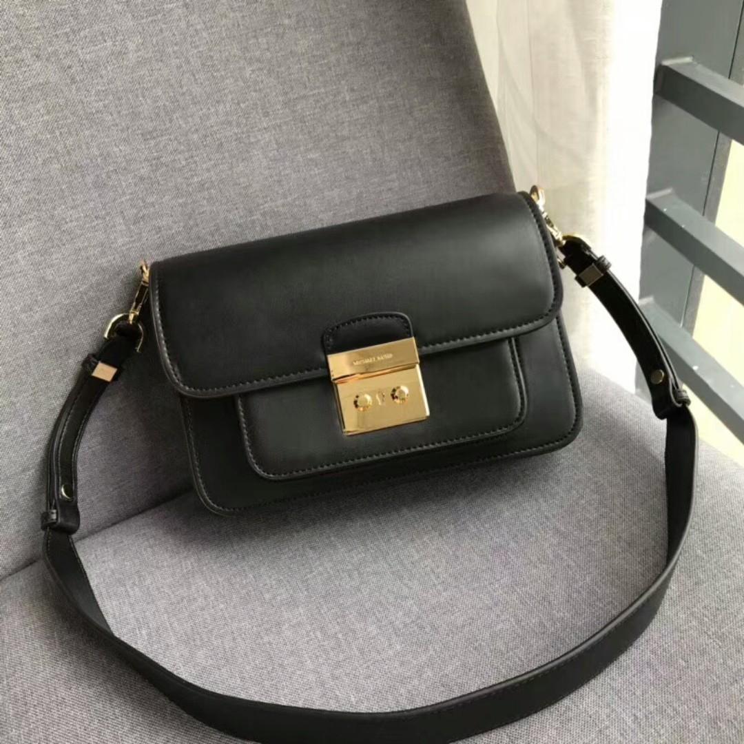 2b002d6c6a24 Michael Kors black sling bag