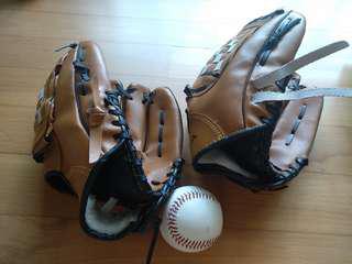 Softball large and medium gloves and ball.