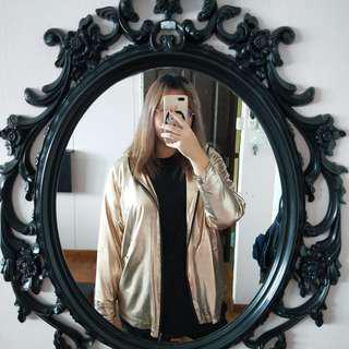 gold raincoat / jacket