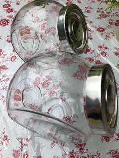A pair of Ikea glass jars with lids
