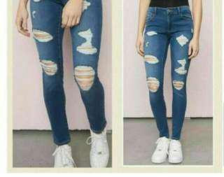 High waisted garage ripped jeans