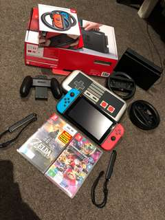 Nintendo switch consoles + 2 Games