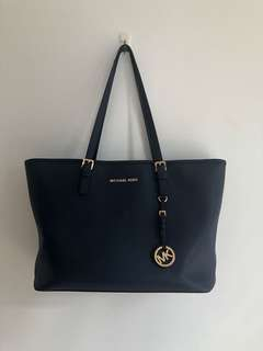 Authentic Michael Kors navy jetset