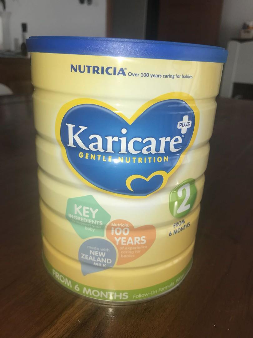 Baby milk formula tins - Karicare and Aptamil - purchased in