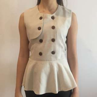 Sleeveless beige/cream blouse