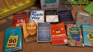 Assortment of wealth, leadership and management related books