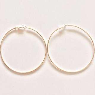 Large-sized gold hoop earrings