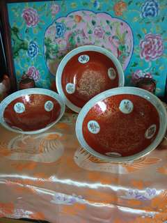 Chinese bowls with orange and gold drawings