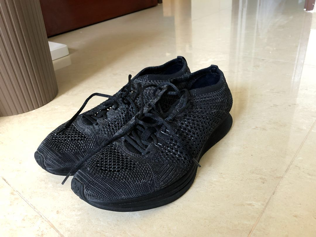 6565bbf64430 flyknit racers triple black us9