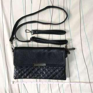 Brand new convertible sling bag/wristlet