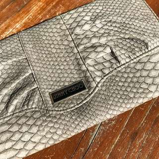 Jimmy clutch with detachable strap