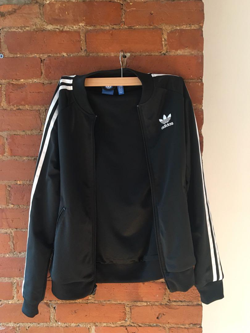 Never before worn Adidas track jacket size small!!