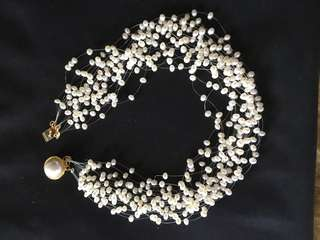 Floating freshwater Pearls gold clasp