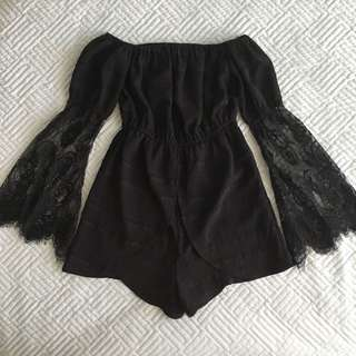 Tiger Mist Size S (6-8) Magnet playsuit in black with lace flare sleeve