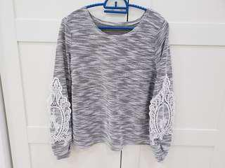 Knitted top with lace design