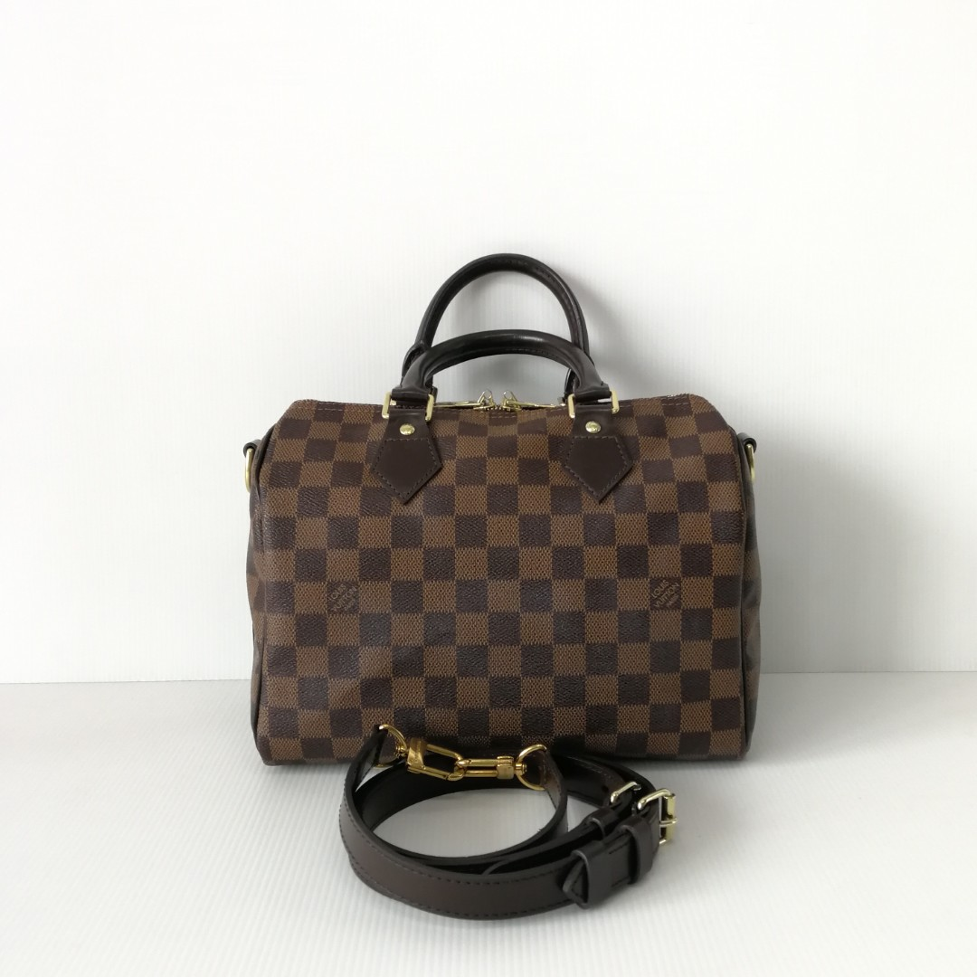 f7f86ef1babe Authentic Louis Vuitton Speedy 25 Damier Ebene Bandouliere, Luxury, Bags &  Wallets on Carousell