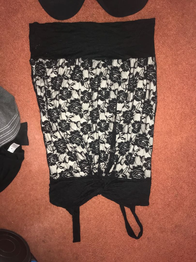 Bundle of woman's clothes includes skirts, pants, shorts, long and short sleeve tops from size s to XL