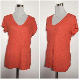 Orange vneck shirt