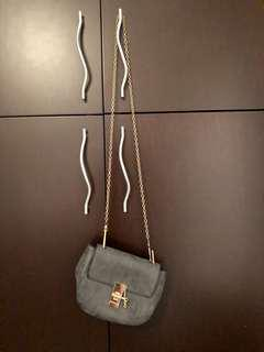 Grey suede purse with gold chain