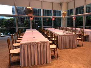 Long tables and chairs with skirting