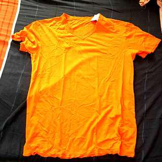 Folded and Hung Orange V Neck Shirt