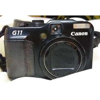 Canon G11 10MP Digital Camera with 5x Wide Angle Optical Stabilized Zoom and 2.8-inch articulating LCD