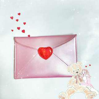 粉紅信封夾包