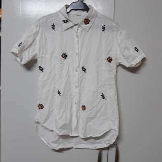 Embroidered polo with small stain