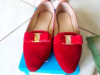 Red balerina shoes
