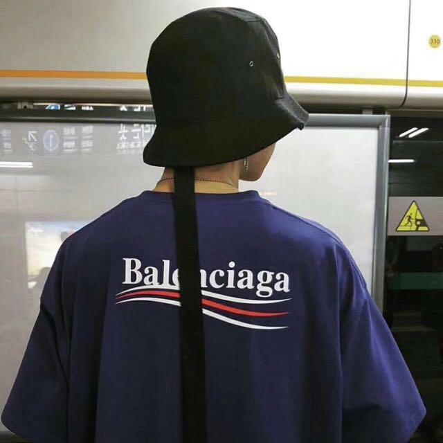 bef11fd5 Balenciaga cola Tee. oversized., Men's Fashion, Clothes, Tops on Carousell