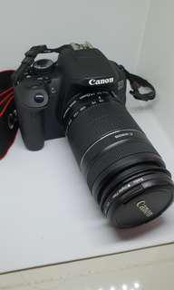 Canon EOS 650D DSLR with two lens and cleaning kit in it.