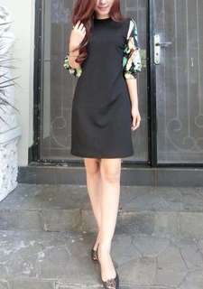 Black dress with tropical accent