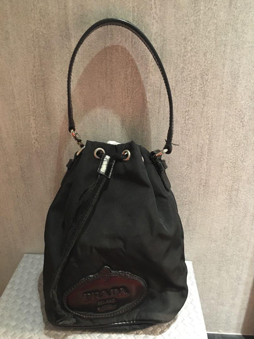 08a2177344707a Prada nylon bucket pouch, Women's Fashion, Bags & Wallets, Handbags ...