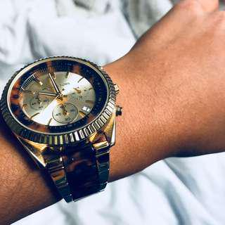 Michael Kors gold/tortoise women's watch