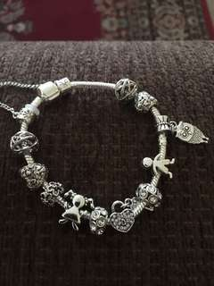 Sterling Silver bracelet with many charms. $30
