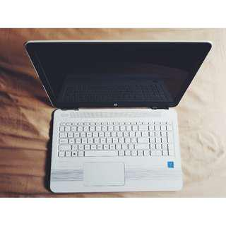 LOOKING FOR 15 INCHES WHITE HP LAPTOP