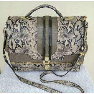 Authentic river island luggage snake skin bag