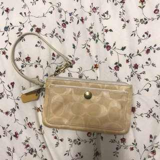 Coach wristlet with leather strap