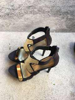 Gold plated heels with suede material