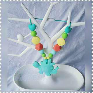 Turquoise Dinosaur Teether with beads Carrier Accessory