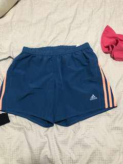 Adidas navy and orange shorts