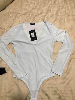Woman's v neck long sleeve body suit
