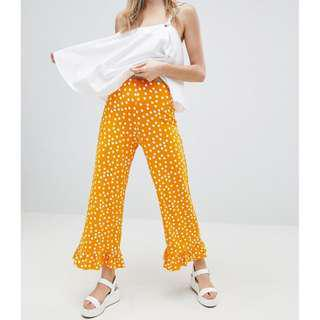 ASOS design pants with fluted ruffle hem in spot print